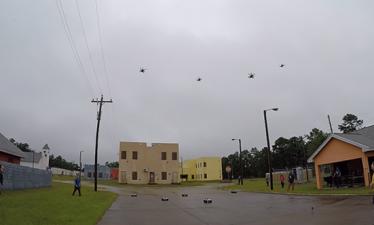В DARPA испытали дронов, обеспечивающих безопасность здания в городе